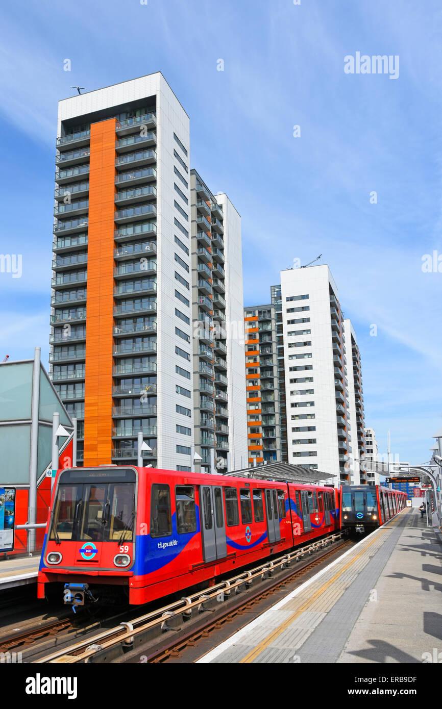 Apartment blocks beside Docklands Light Railway station - Stock Image