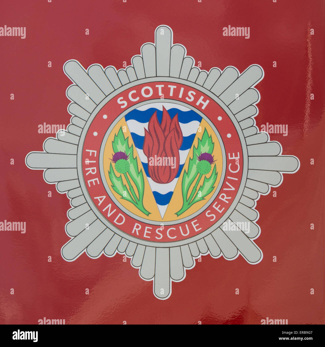 Scottish Fire and Rescue Service badge on the side of a fire engine - Stock Image