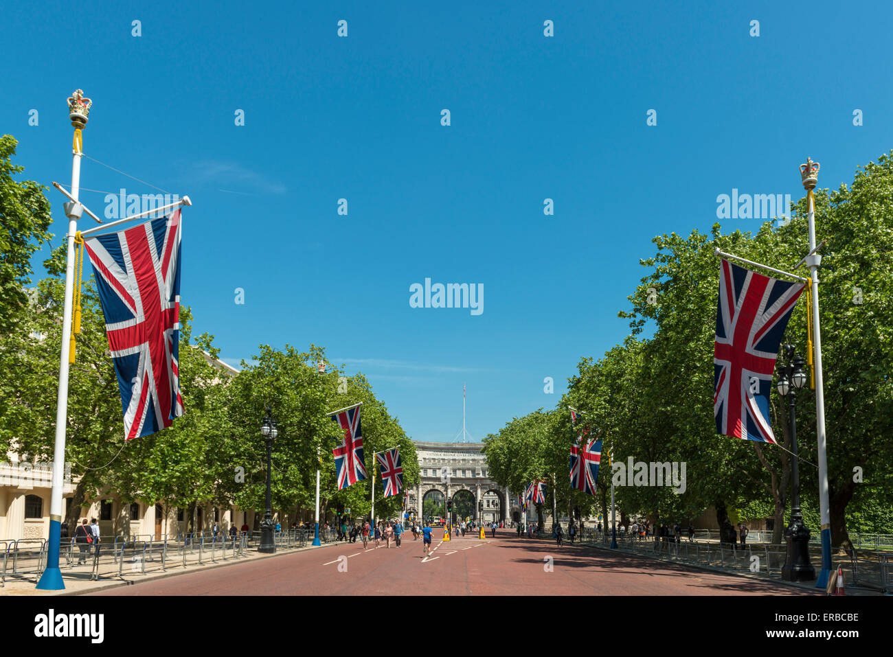 Union flags line The Mall leading to Admiralty Arch in London on a sunny day - Stock Image
