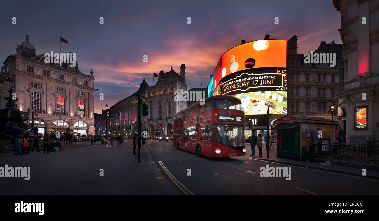 A double-decker bus drives in Piccadilly Circus, in London, England, 2015. (Adrien Veczan) - Stock Image