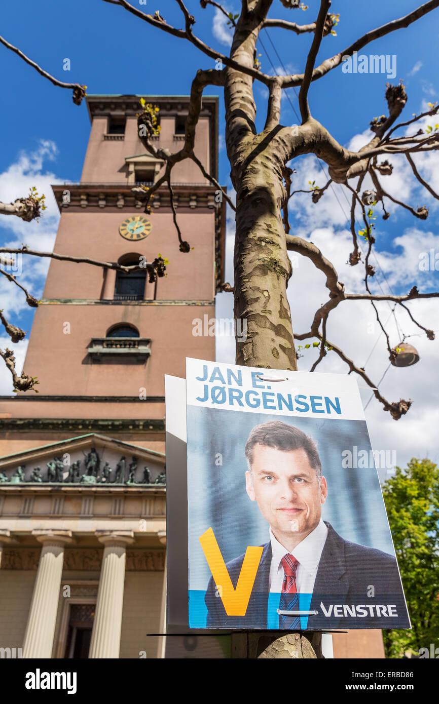 Election poster promoting Jan E. Jørgensen in front of Church of Our Lady, Copenhagen, Denmark Stock Photo