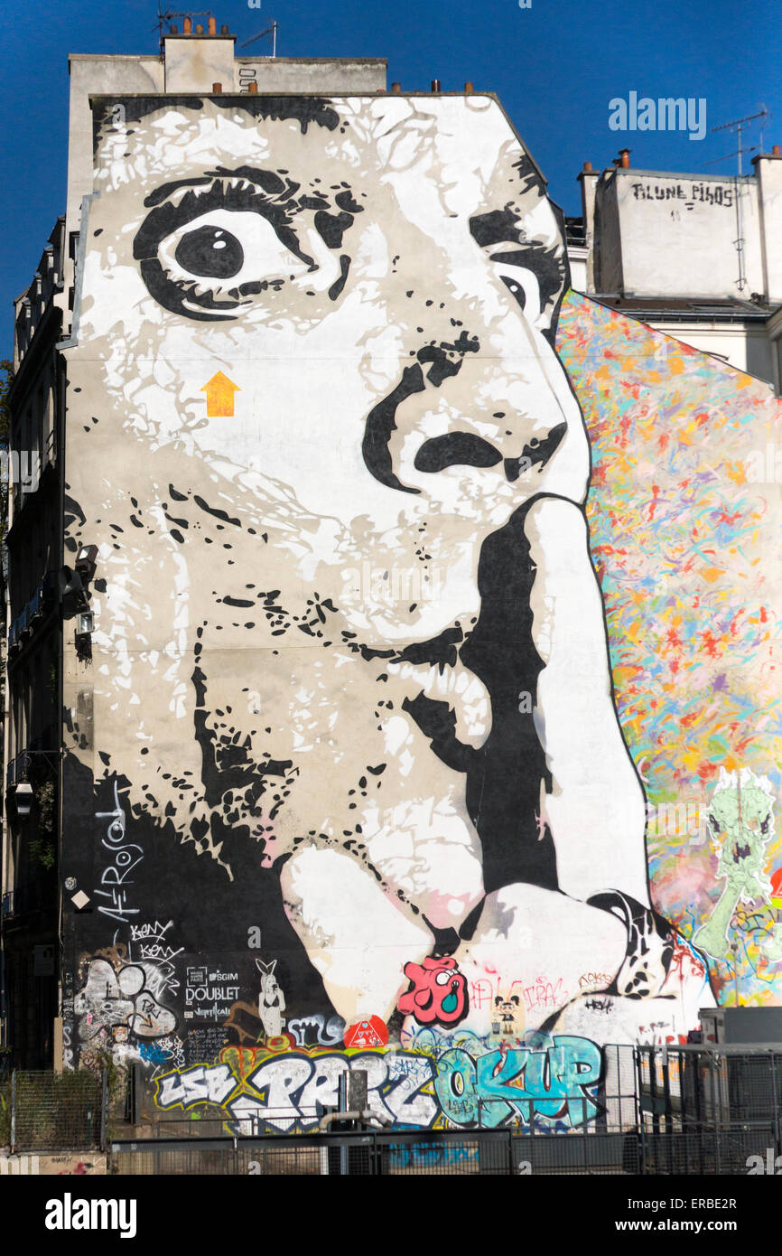 """A huge mural entitled """"Chuuuttt!!!"""" (Hush), in Paris, by French graffiti artist Jef Aérosol in the Place Igor - Stock Image"""