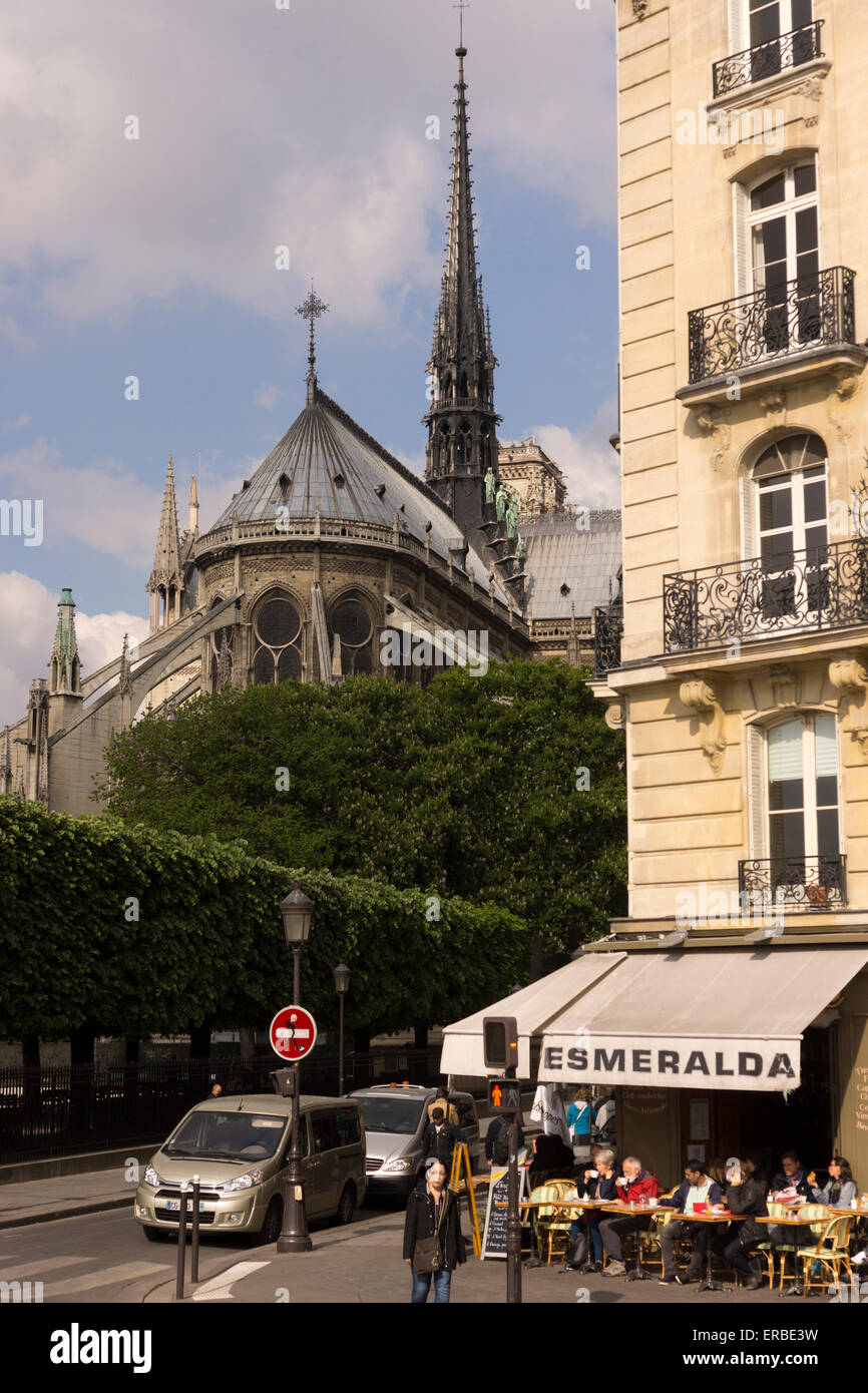 A view of a French cafe and Notre Dame, Paris, taken from Pont Saint Louis - Stock Image