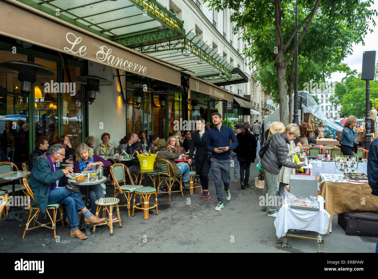 Paris france people sharing meals on cafe terrace near for Garage du marais sucy