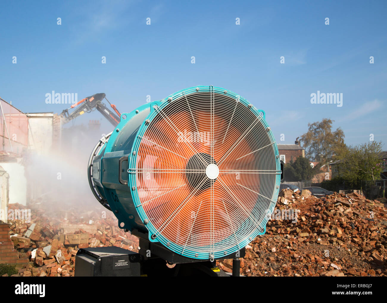 Water cannon spray to dampen dust at a demolition site, Woodbridge, Suffolk,  England, UK - Stock Image