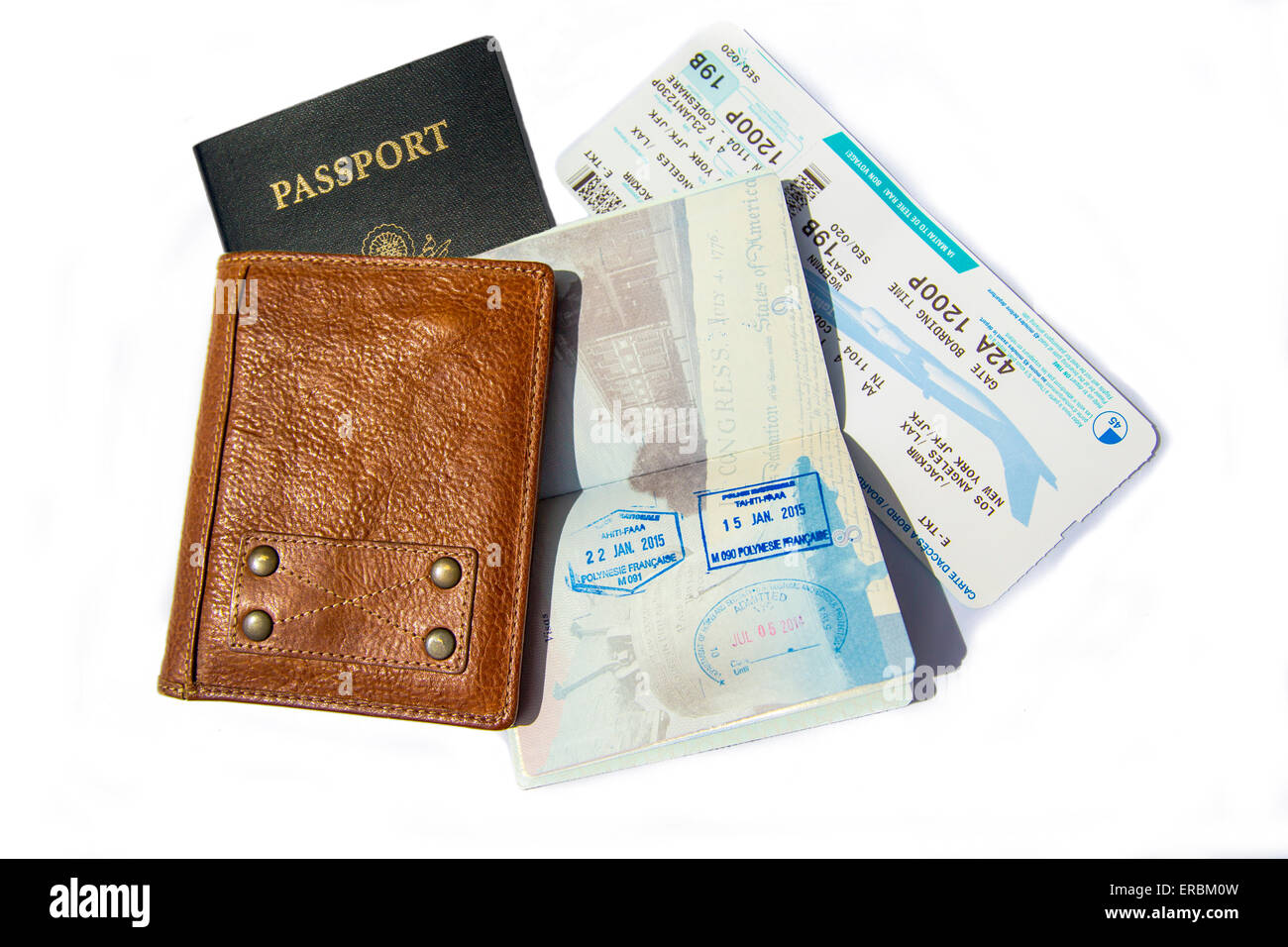 Travel documents. Stamped passport, passport holder and boarding pass - Stock Image