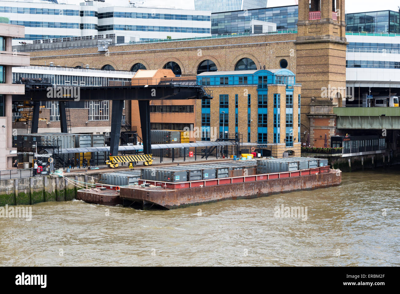 Waste disposal site next to Cannon Street Station, London.  Waste is loaded onto barges for transport down the Thames. - Stock Image