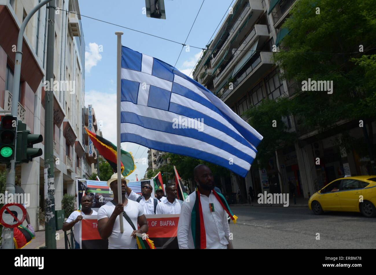 Biafra flag stock photos biafra flag stock images alamy a demonstrator waves a greek flag thecheapjerseys Image collections