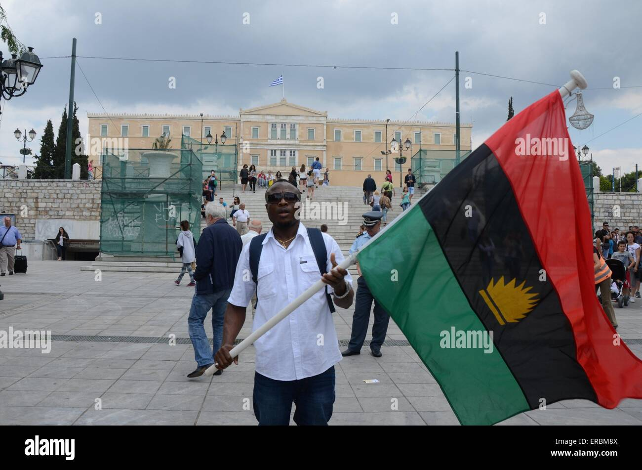 Biafra flag stock photos biafra flag stock images alamy a demonstrator holds a flag of biafra thecheapjerseys Image collections