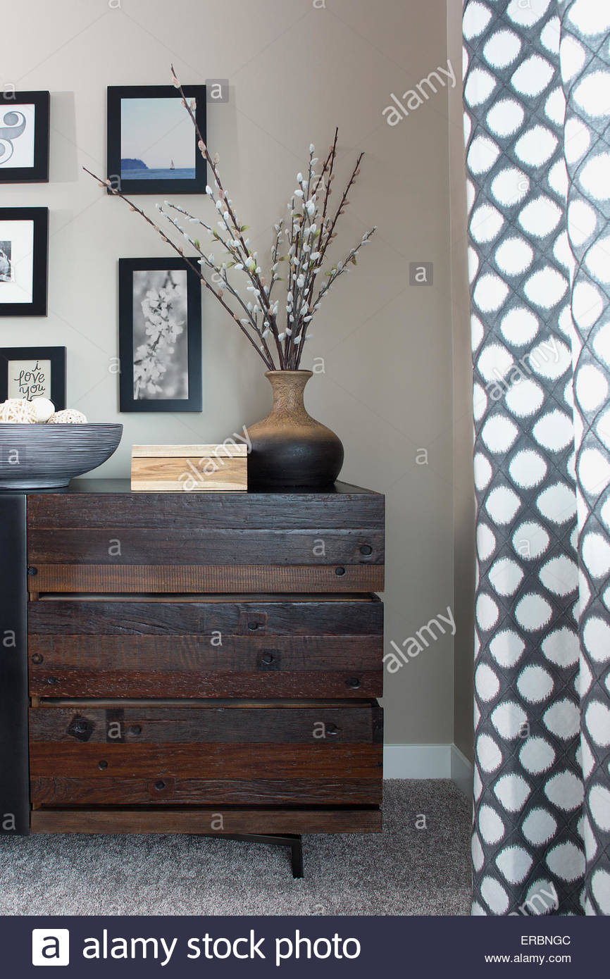 Wooden dresser and decor in bedroom - Stock Image