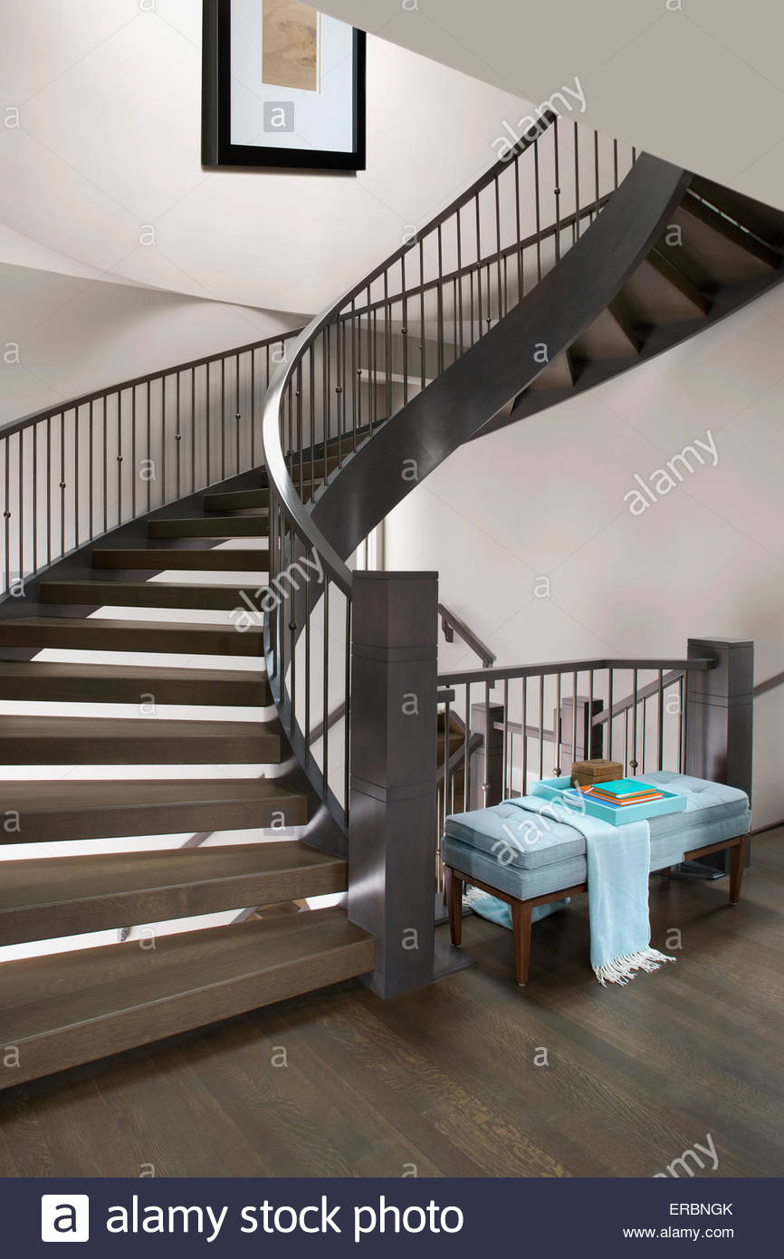 Spiral staircase in elegant home - Stock Image