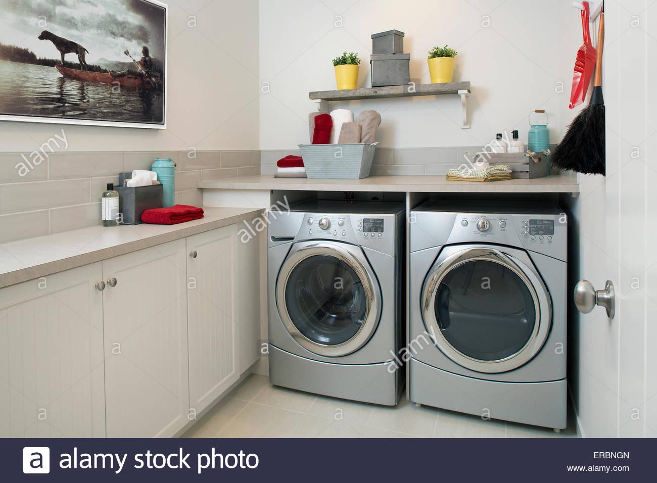 Energy efficient washing machine and dryer laundry room - Stock Image