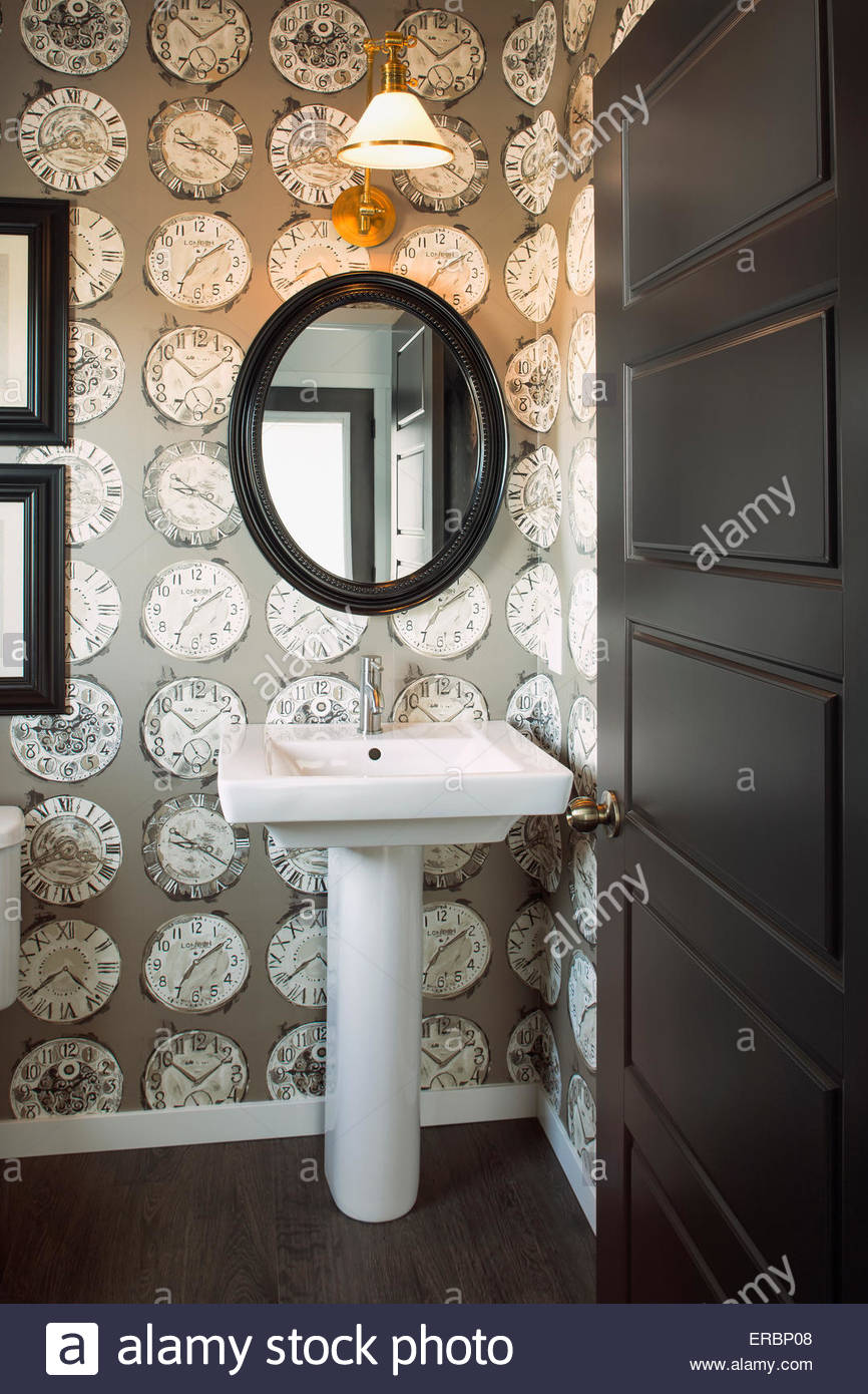 Clock wallpaper in powder bathroom - Stock Image
