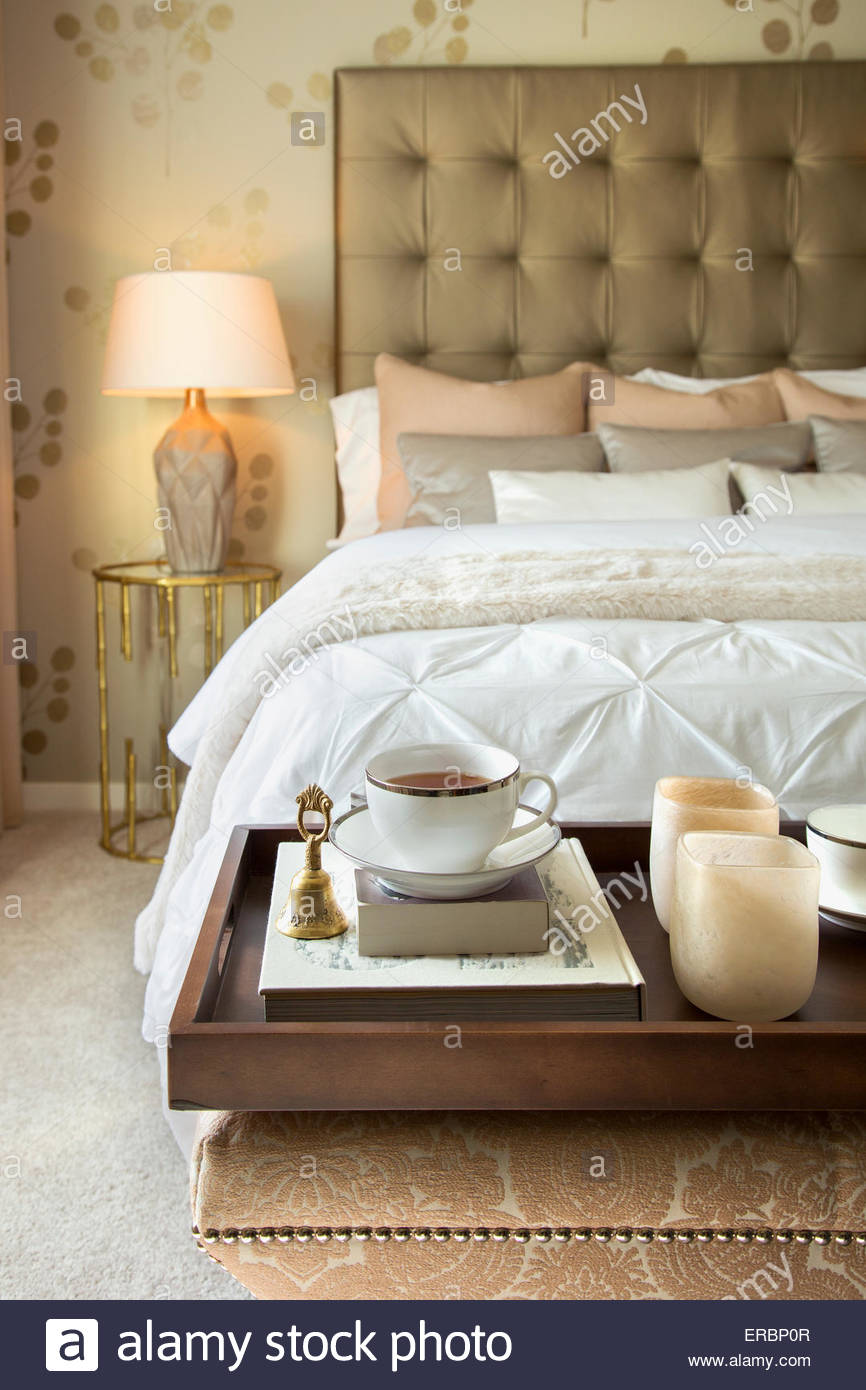 Tea tray on bench end of elegant bed - Stock Image