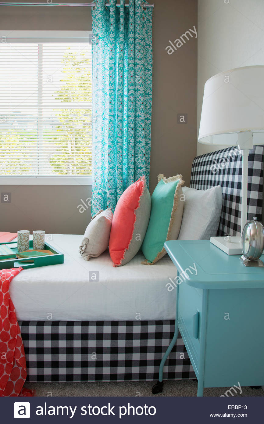 Coral And Seafoam Green Decor On Gingham Bed   Stock Image