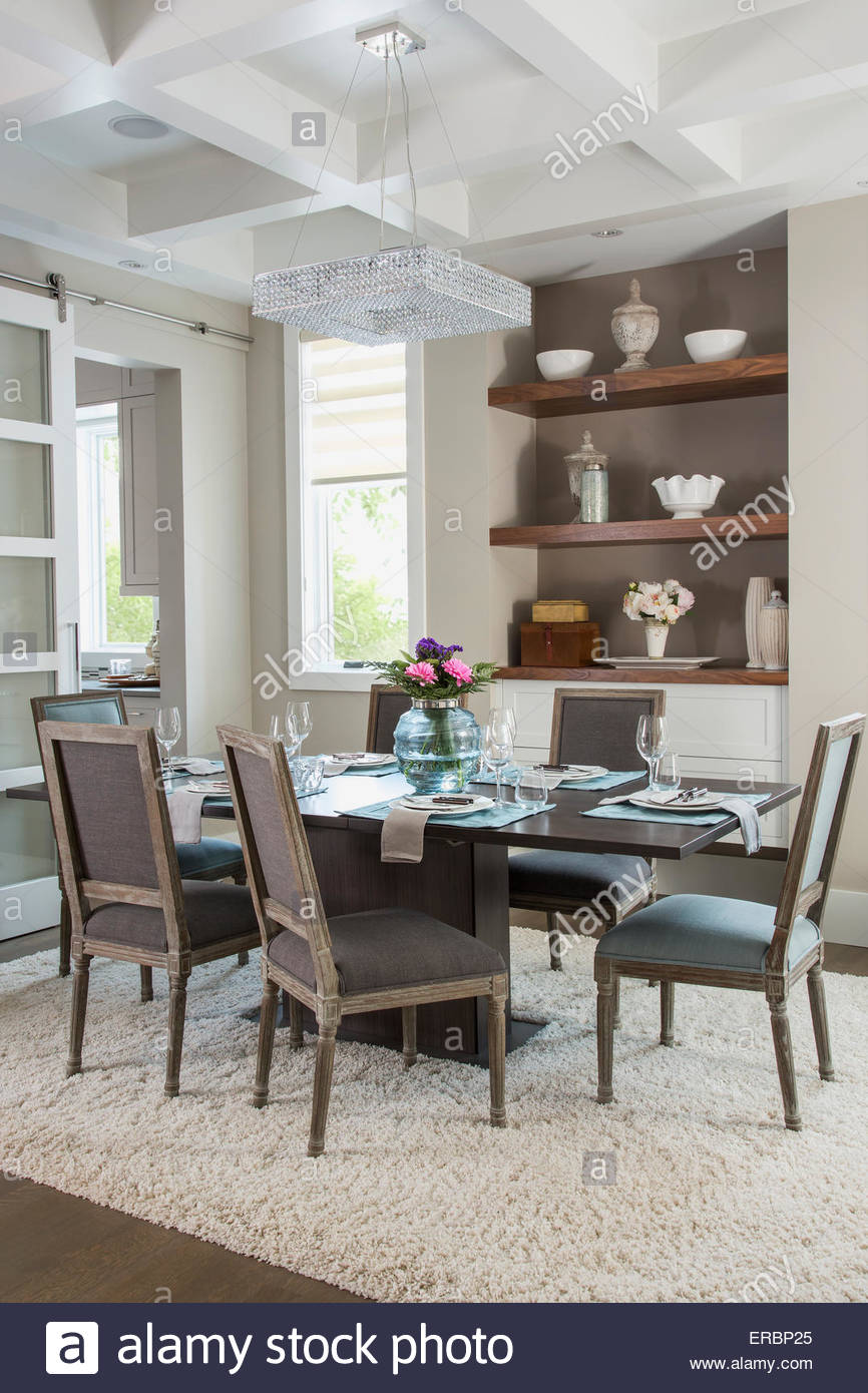 Elegant dining room with tray ceiling - Stock Image