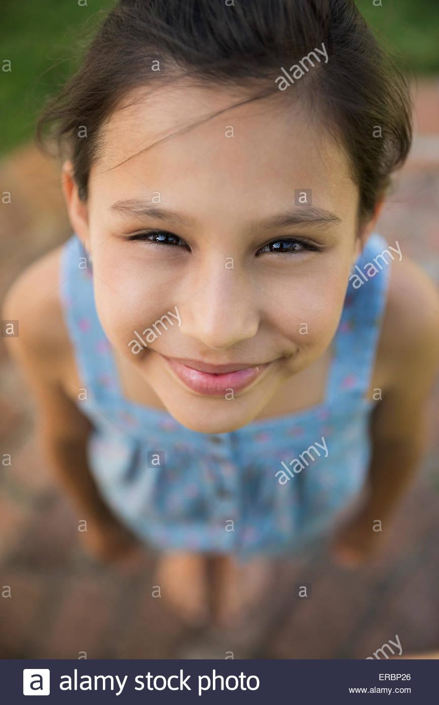 Close up portrait smiling girl - Stock Image