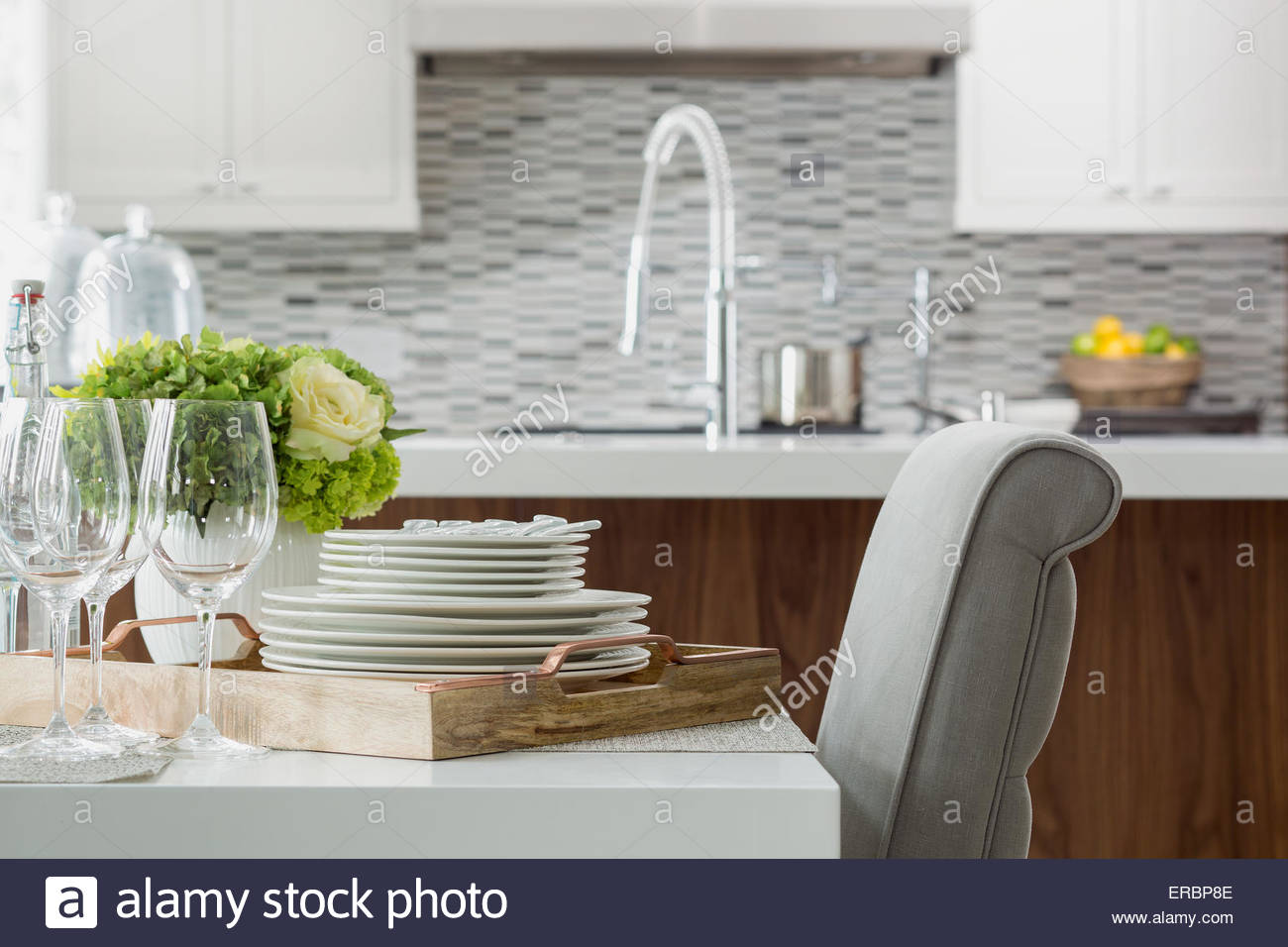 Place settings on tray elegant dining room table - Stock Image