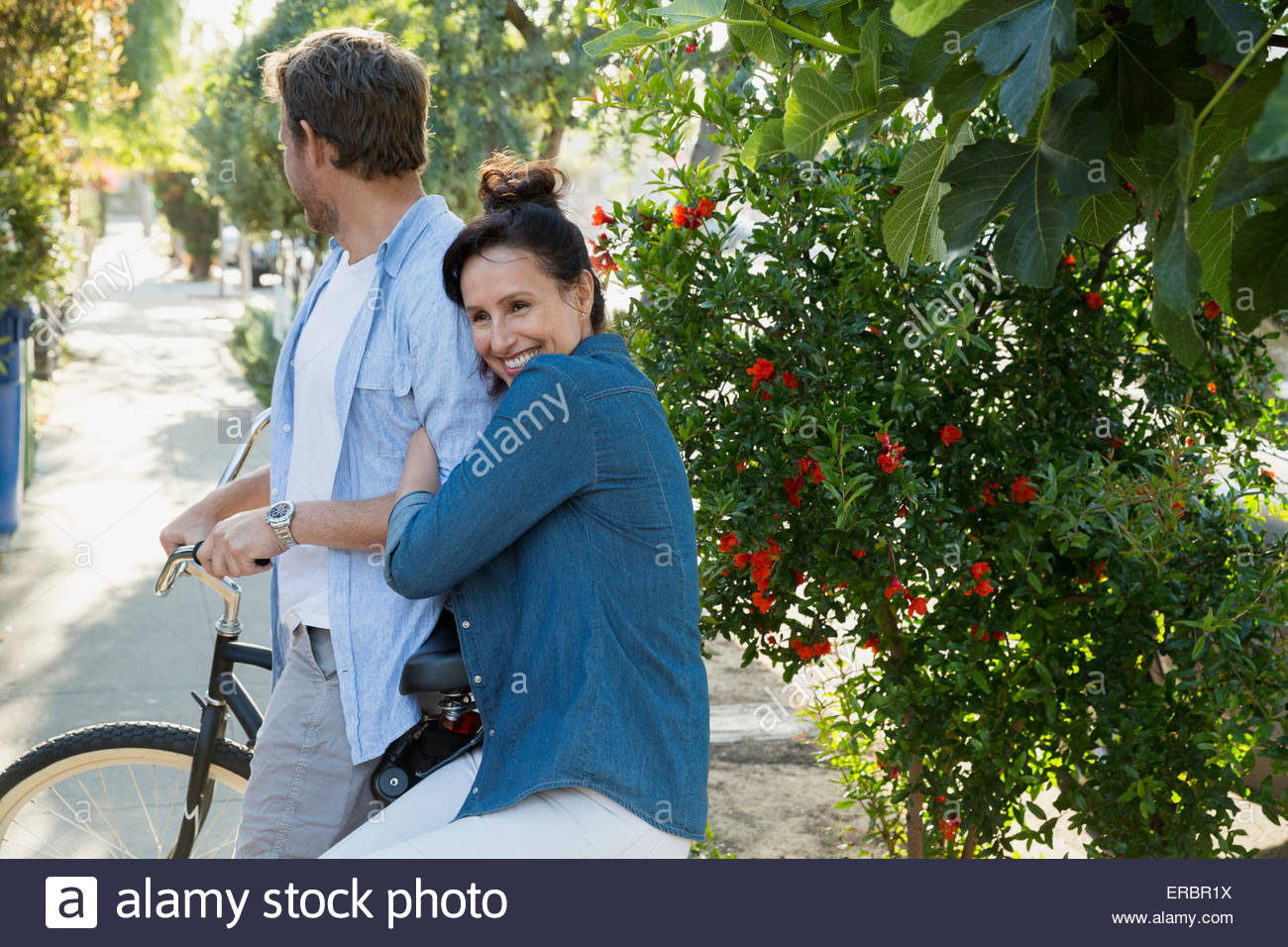 Portrait affectionate couple on bicycle Stock Photo