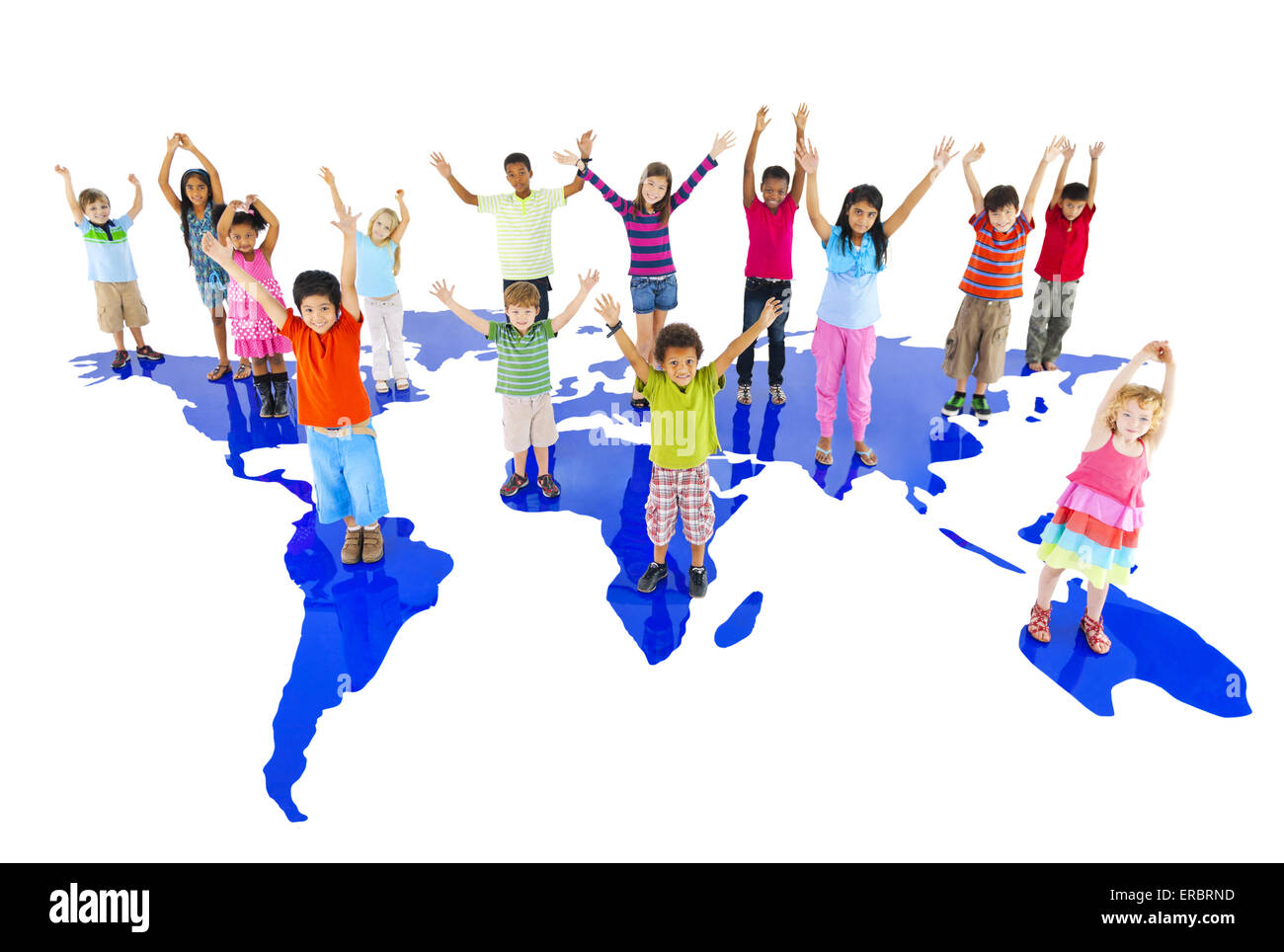 Group of children hands up and standing on the world map - Stock Image
