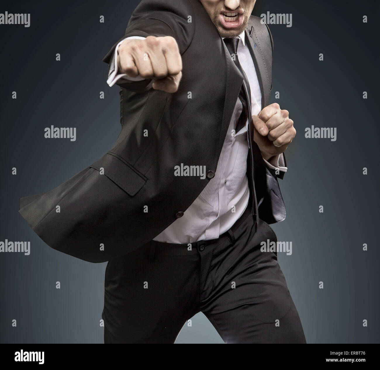 Brave manager fighting against challengers - Stock Image