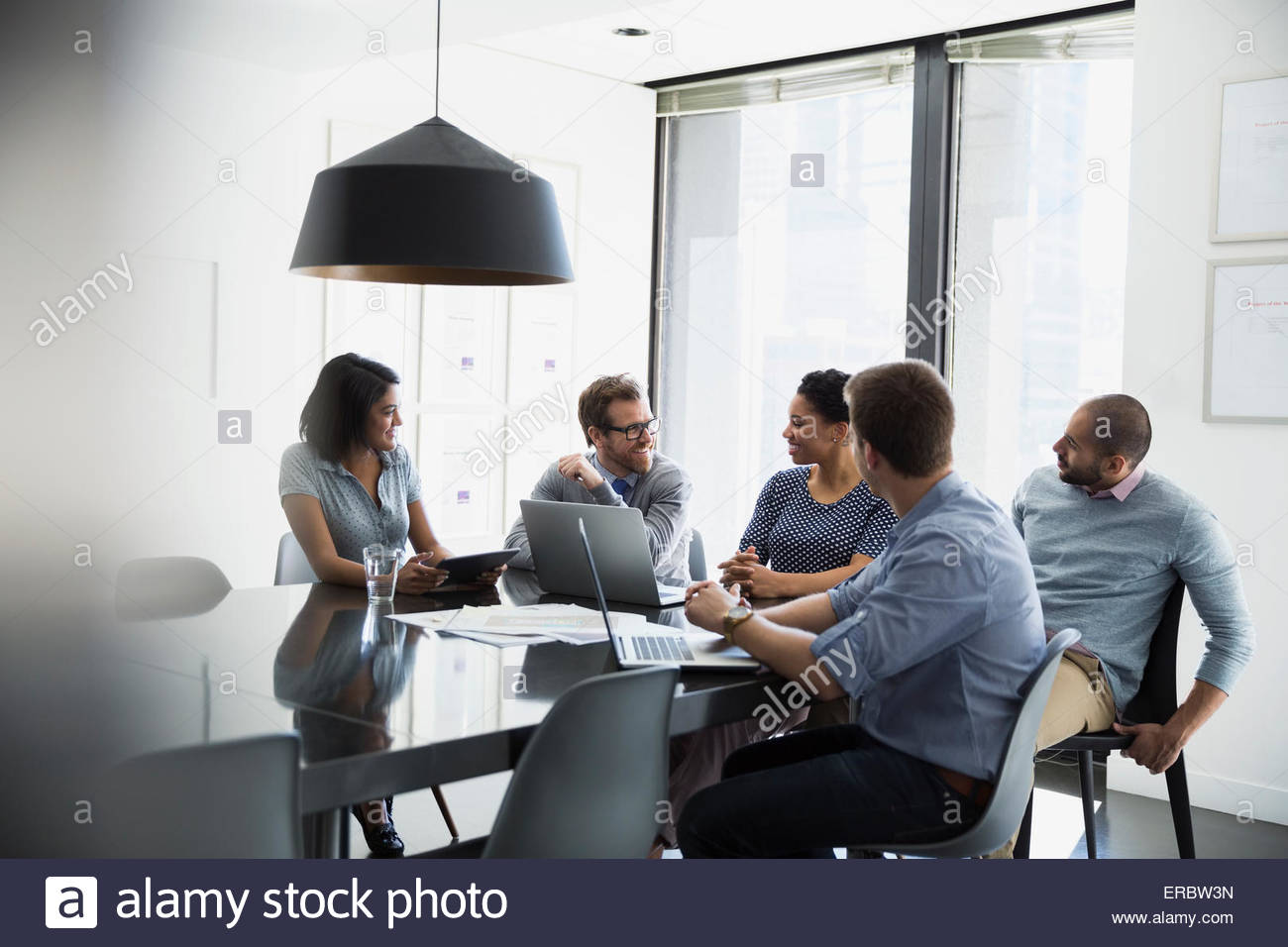 Business people talking in conference room meeting - Stock Image