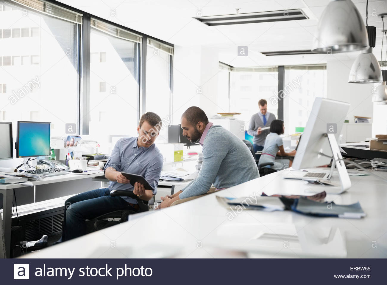 Designers working with digital tablet in office - Stock Image