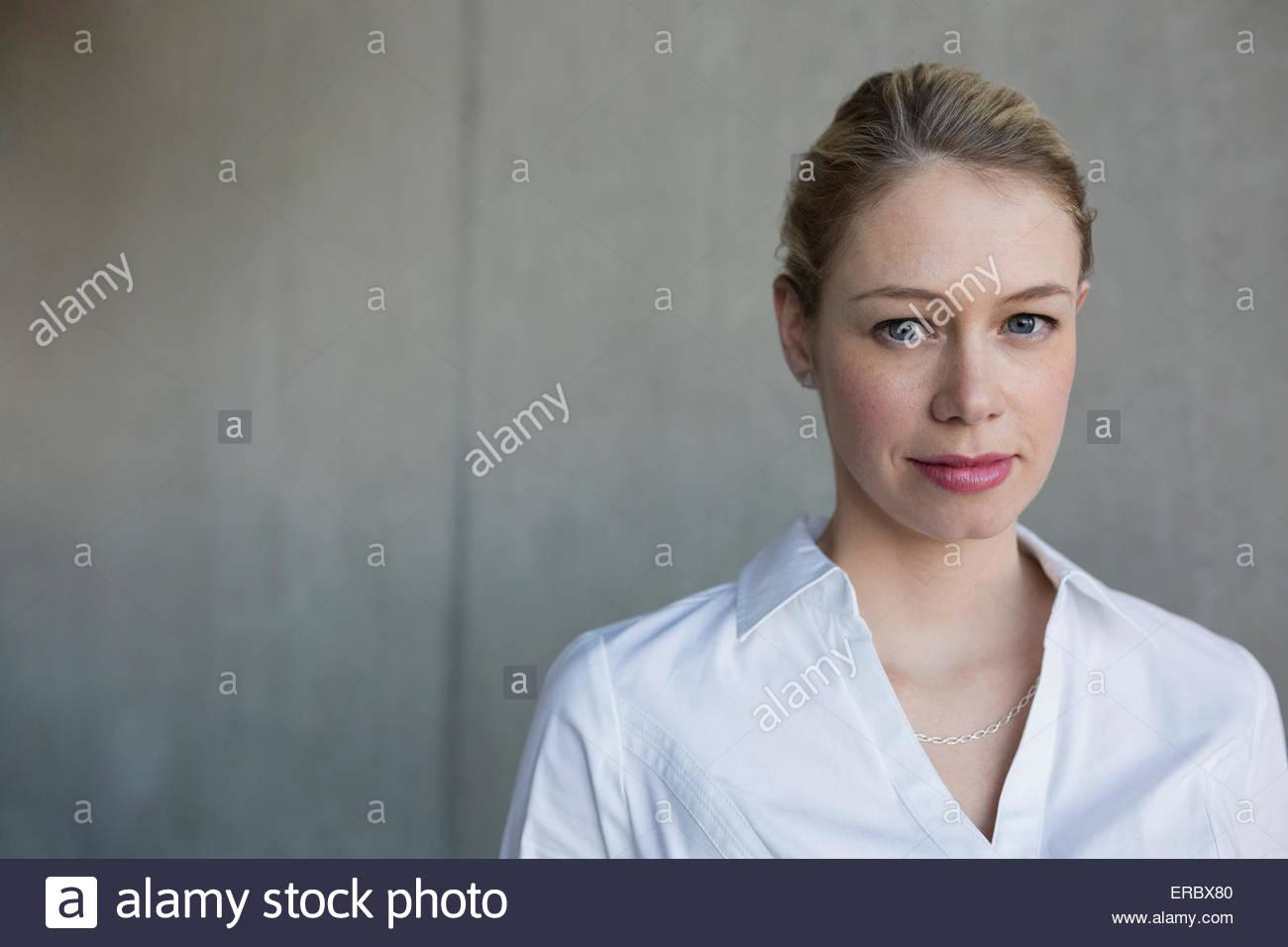 Portrait confident businesswoman with blonde hair - Stock Image