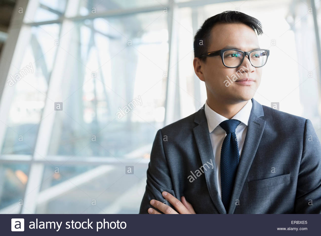 Pensive businessman in suit looking away - Stock Image