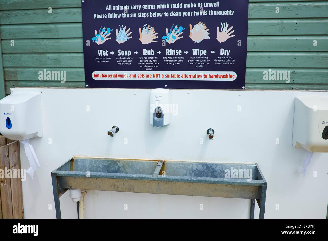 Hand Wash Station For Visitors To Use After Feeding The Animals Cotswold Farm Park Bemborough Farm Kineton UK - Stock Image