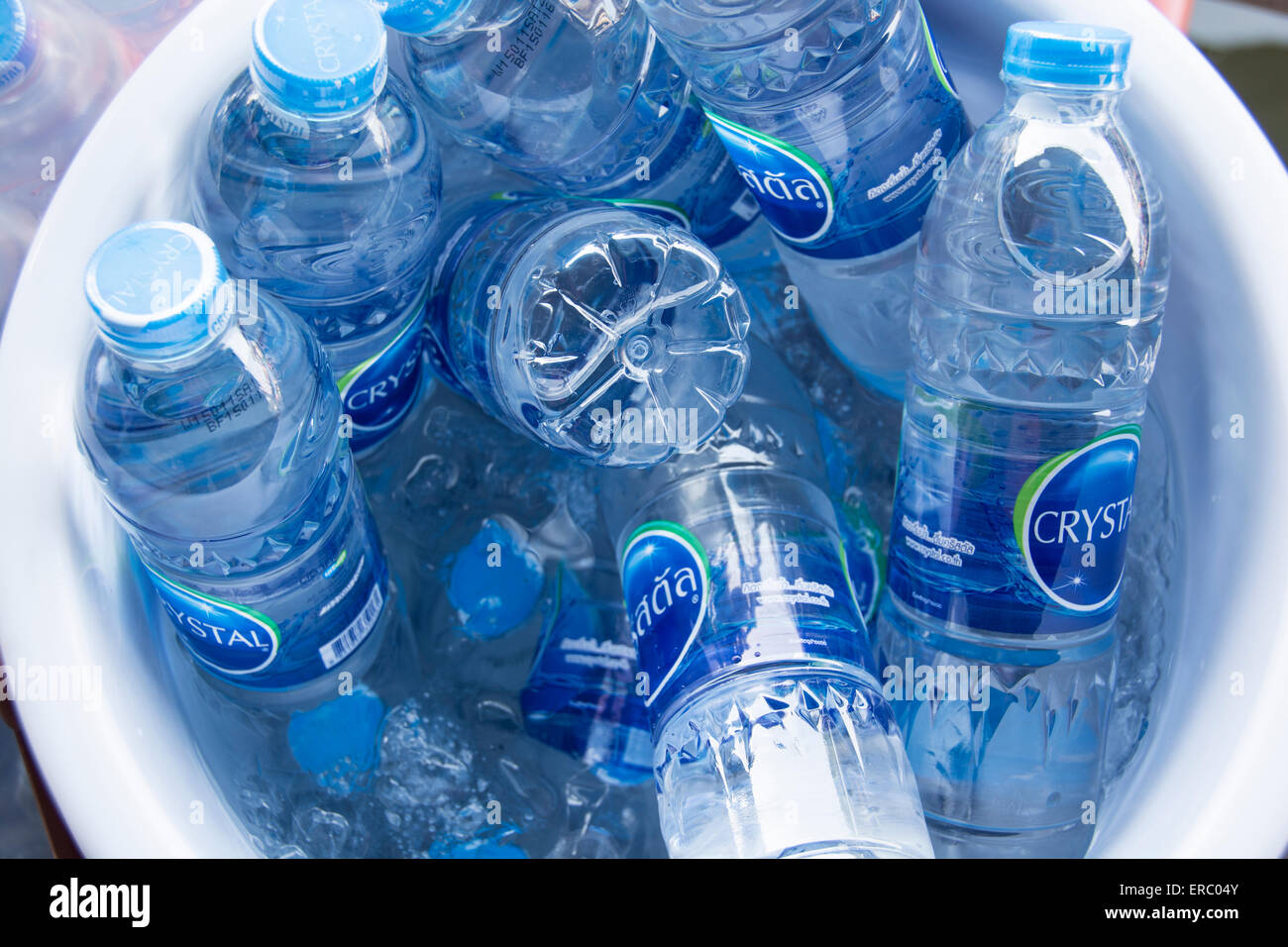 A bucket of bottled waters. - Stock Image