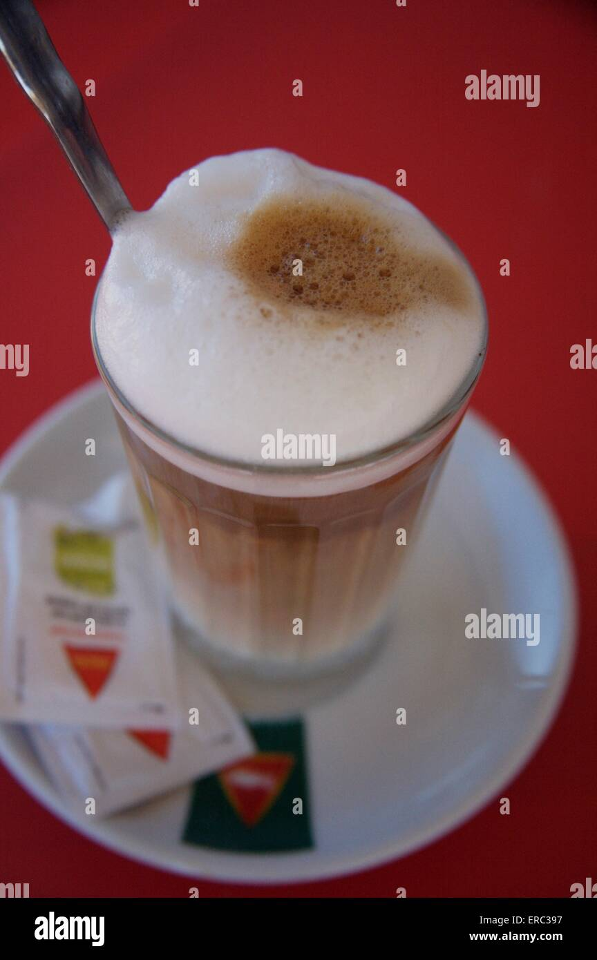 A 'galao' milky coffee in Portugal. Weak coffee plus hot milk in a glass, usually only drunk at breakfast - Stock Image