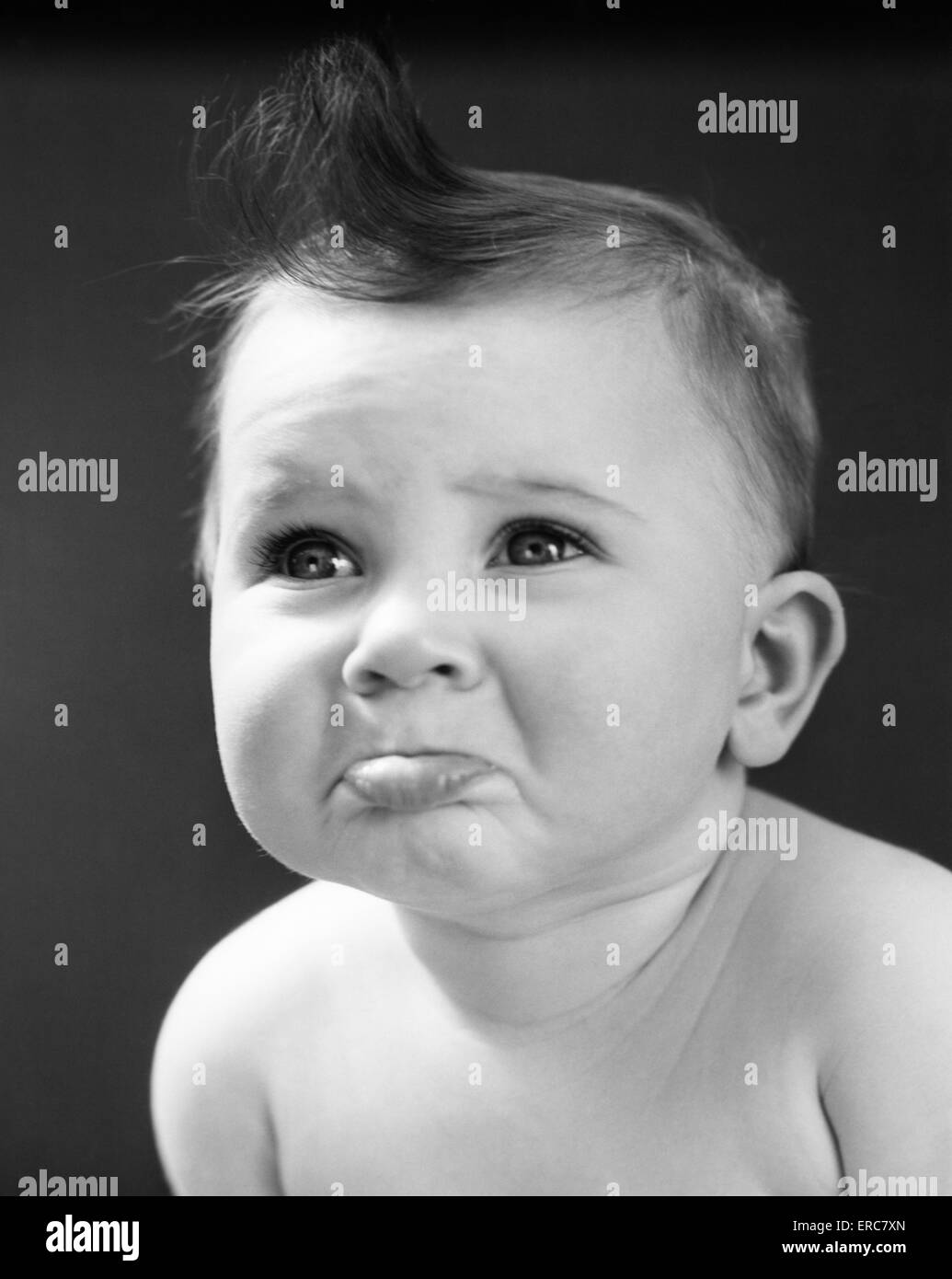 1940s 1950s sad baby with pouting lower lip extended about to cry