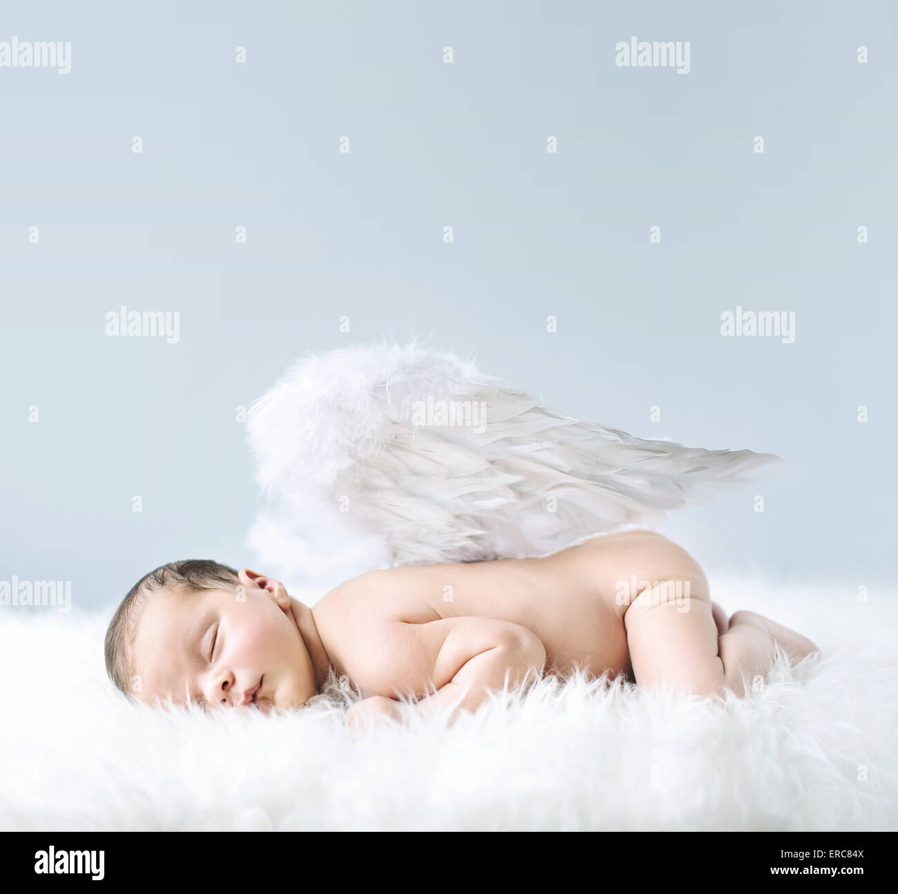 Newborn baby as an cute angel Stock Photo