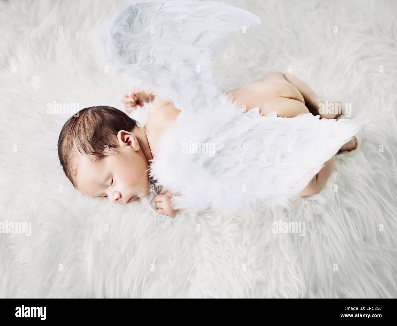 Cute little angel during a short nap - Stock Image
