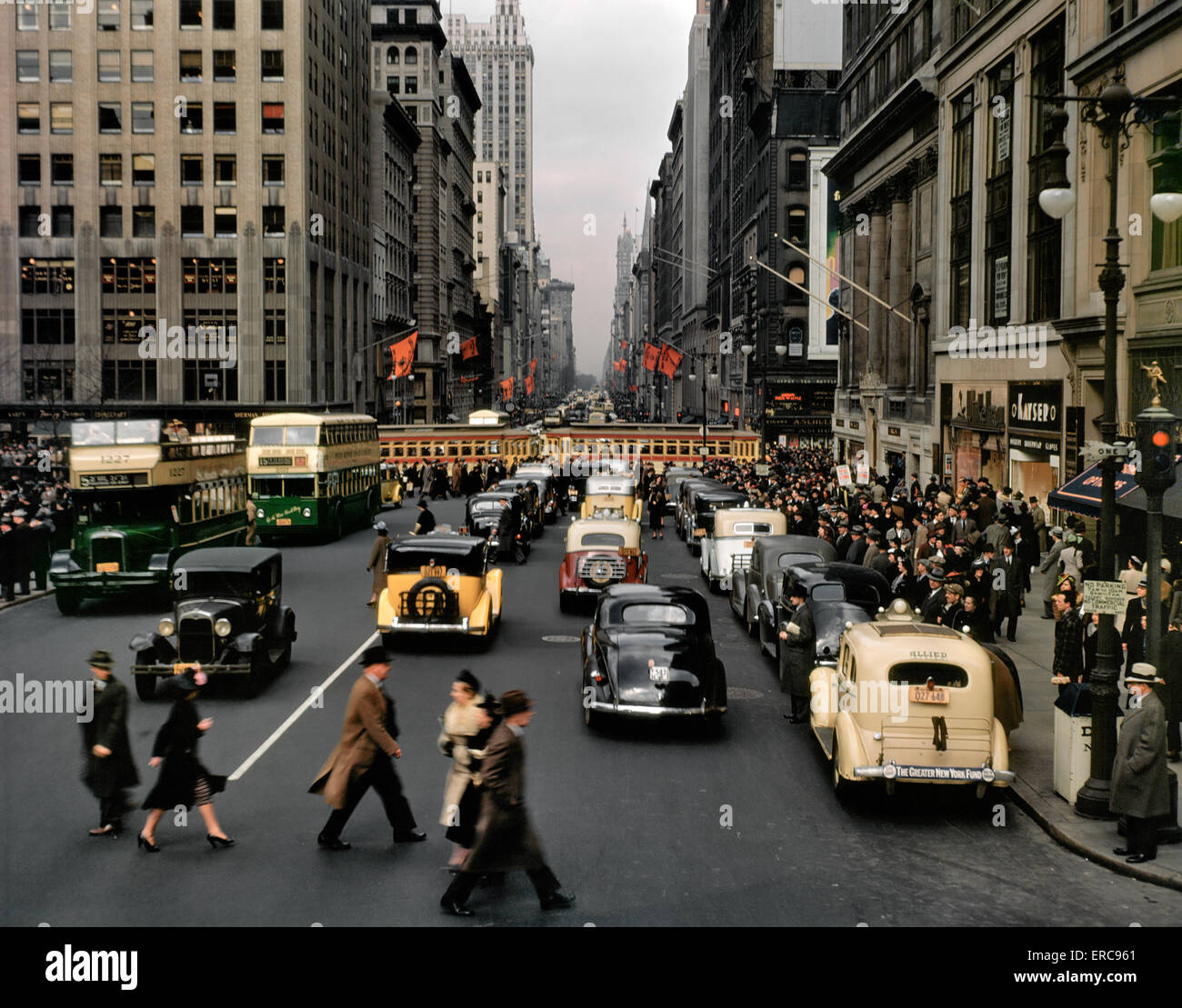1940s PEDESTRIANS CARS TAXIS BUSES TROLLEY TRAFFIC FIFTH AVENUE LOOKING NORTH FROM JUST BELOW 42nd STREET MANHATTAN Stock Photo