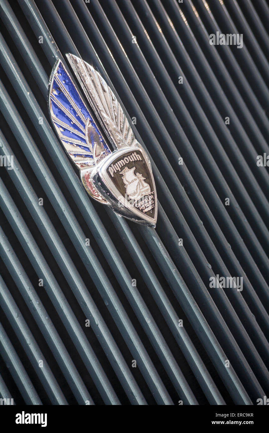 Plymouth Chrysler Motors Product badge on front grille of Plymouth car - Stock Image
