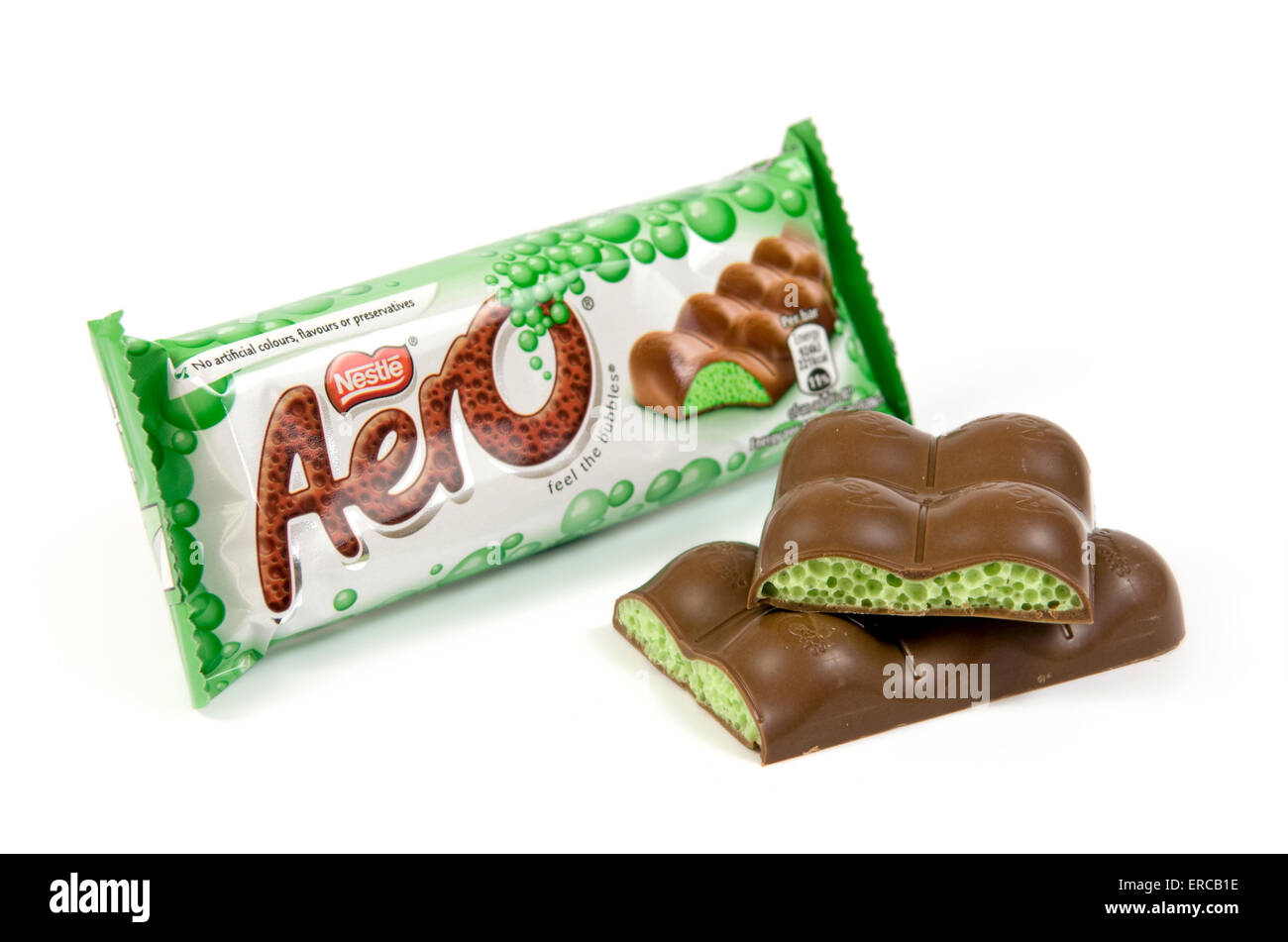 Peppermint aero chocolate bar on white background with open cut up bar by the side - Stock Image