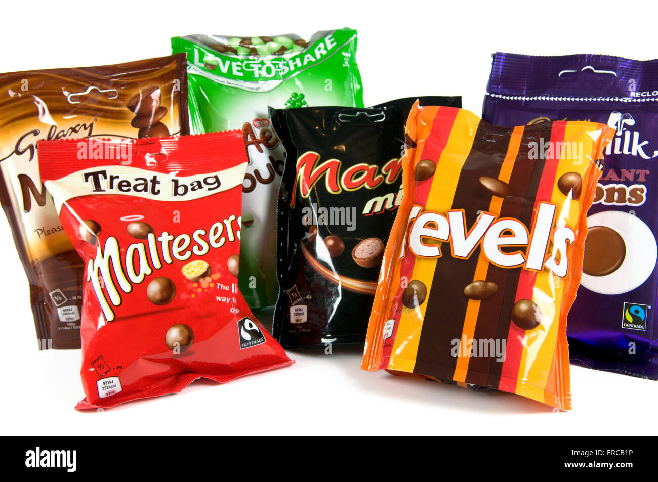 Mix of chocolate sharing bags on white background including maltesers, revels, mars mix, aero peppermint, minstrels - Stock Image