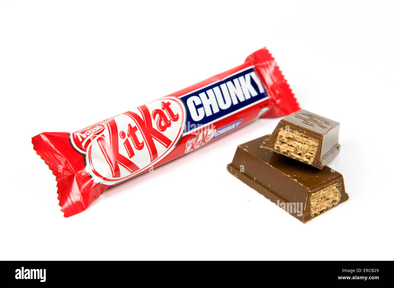 Chunky kitkat bar on white background with open cut up bar by the side - Stock Image