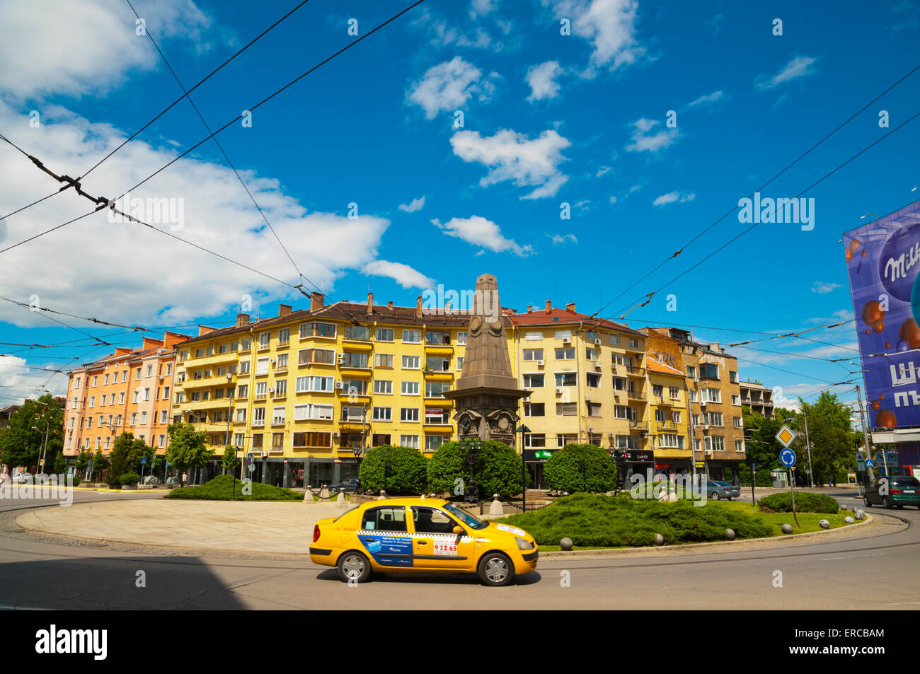 Taxi, at roundabout with monument to Vasil Levski, central Sofia, Bulgaria, Europe - Stock Image