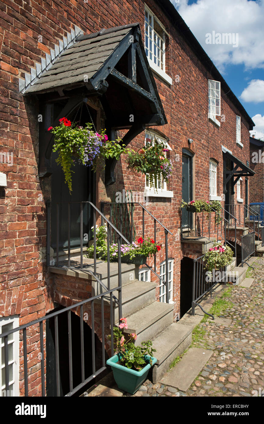UK, England, Cheshire, Styal, Oak Cottages, mill worker's homes with separately inhabited cellars below - Stock Image