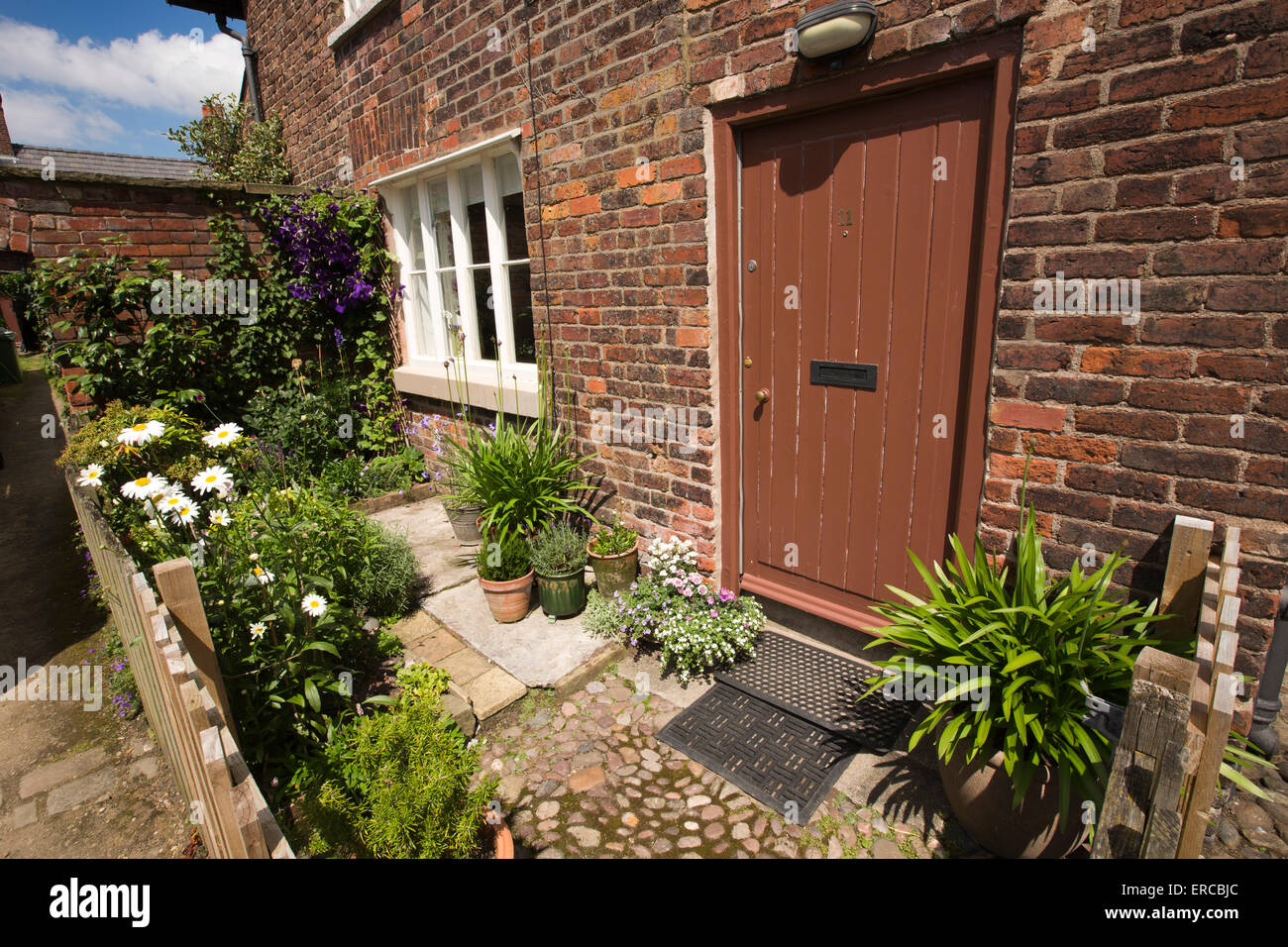 UK, England, Cheshire, Styal, Farm Fold small front garden with ...