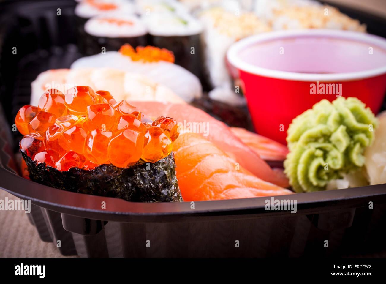Selective focus of salmon caviar ikura sushi closeup - Stock Image