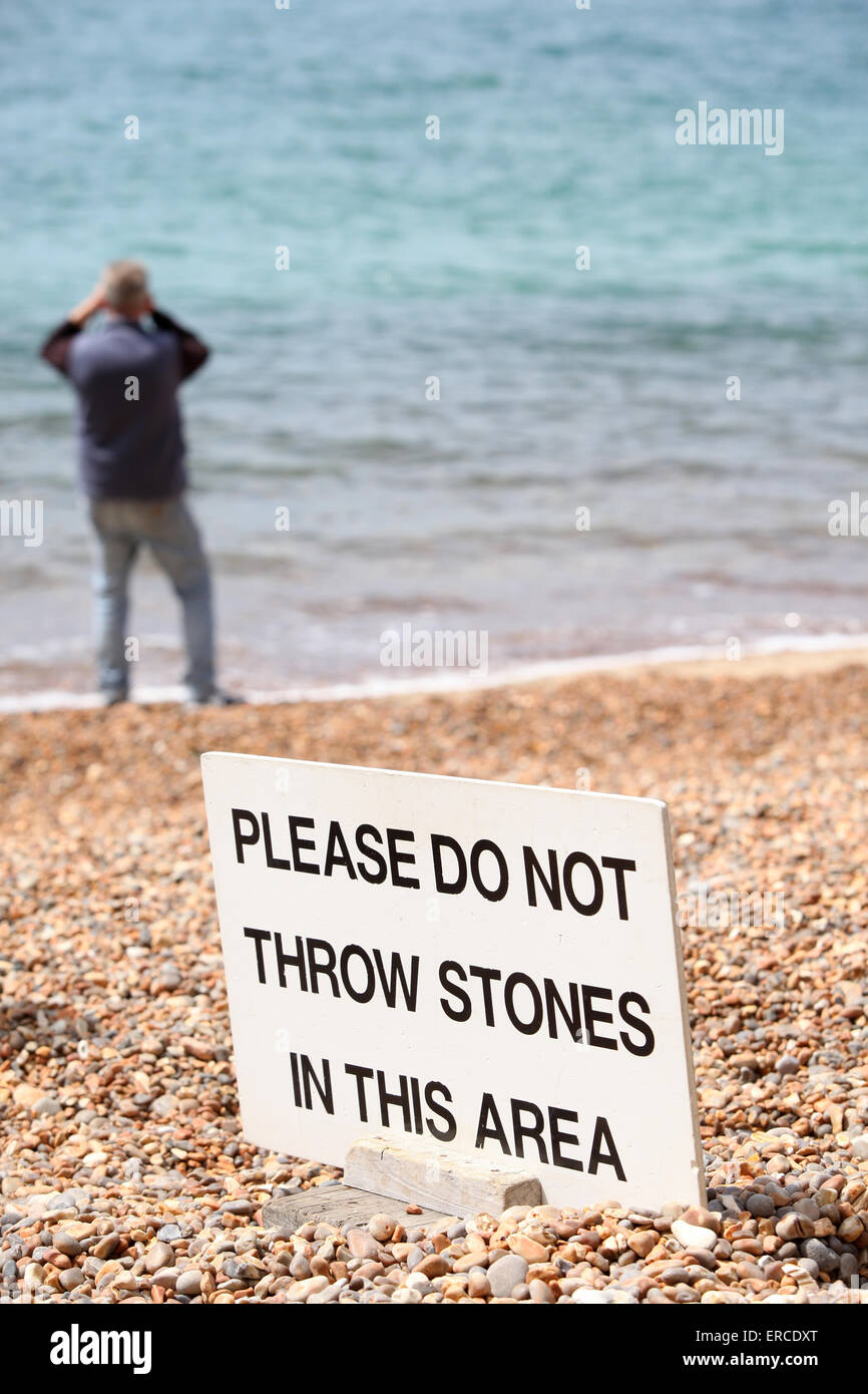 Do Not Throw Stones sign on an English Beach - Stock Image