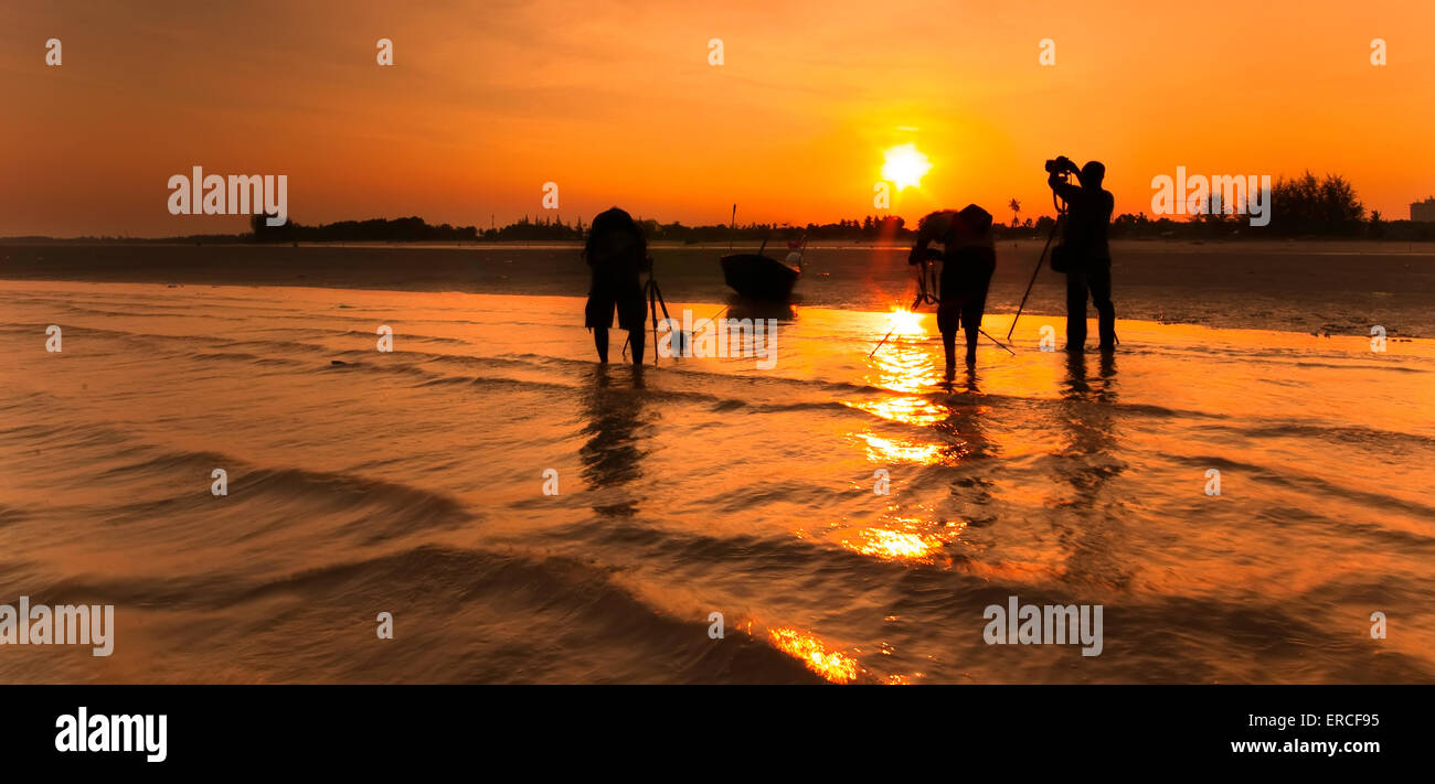 a fisherman boat and three photography at the beach. image might contain softness and little noise due to long exposure - Stock Image