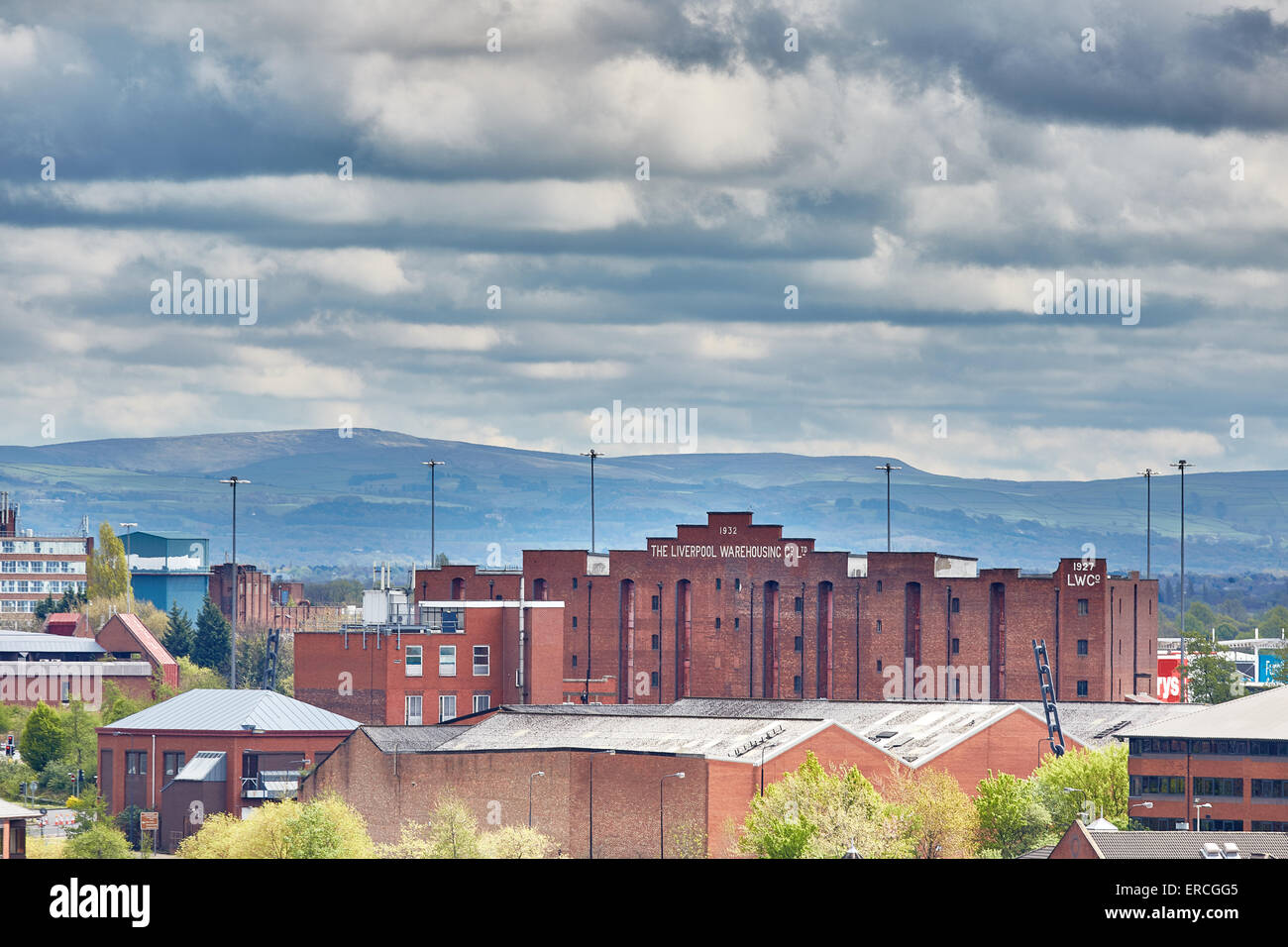 The Liverpool Warehousing Company buildings with the Pennines behind at Salford Quays - old Trafford      UK Great - Stock Image