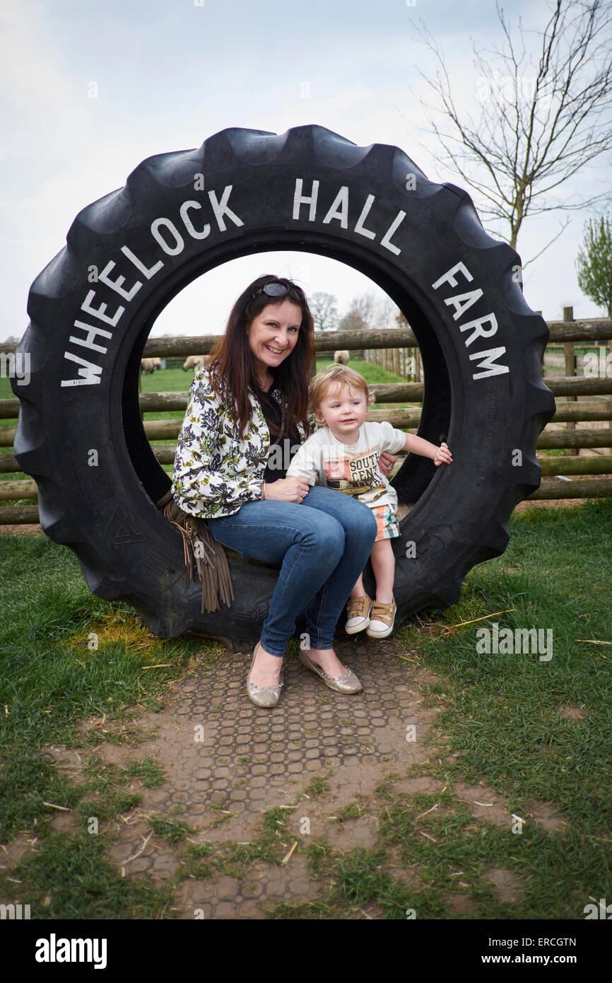Wheelock Hall farm tyre display tractor Crewe Cheshire Uk - Stock Image