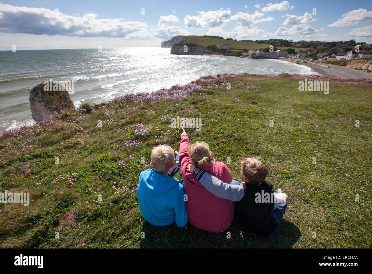 A Family enjoy the view of Freshwater Bay on the Isle of Wight - Stock Image