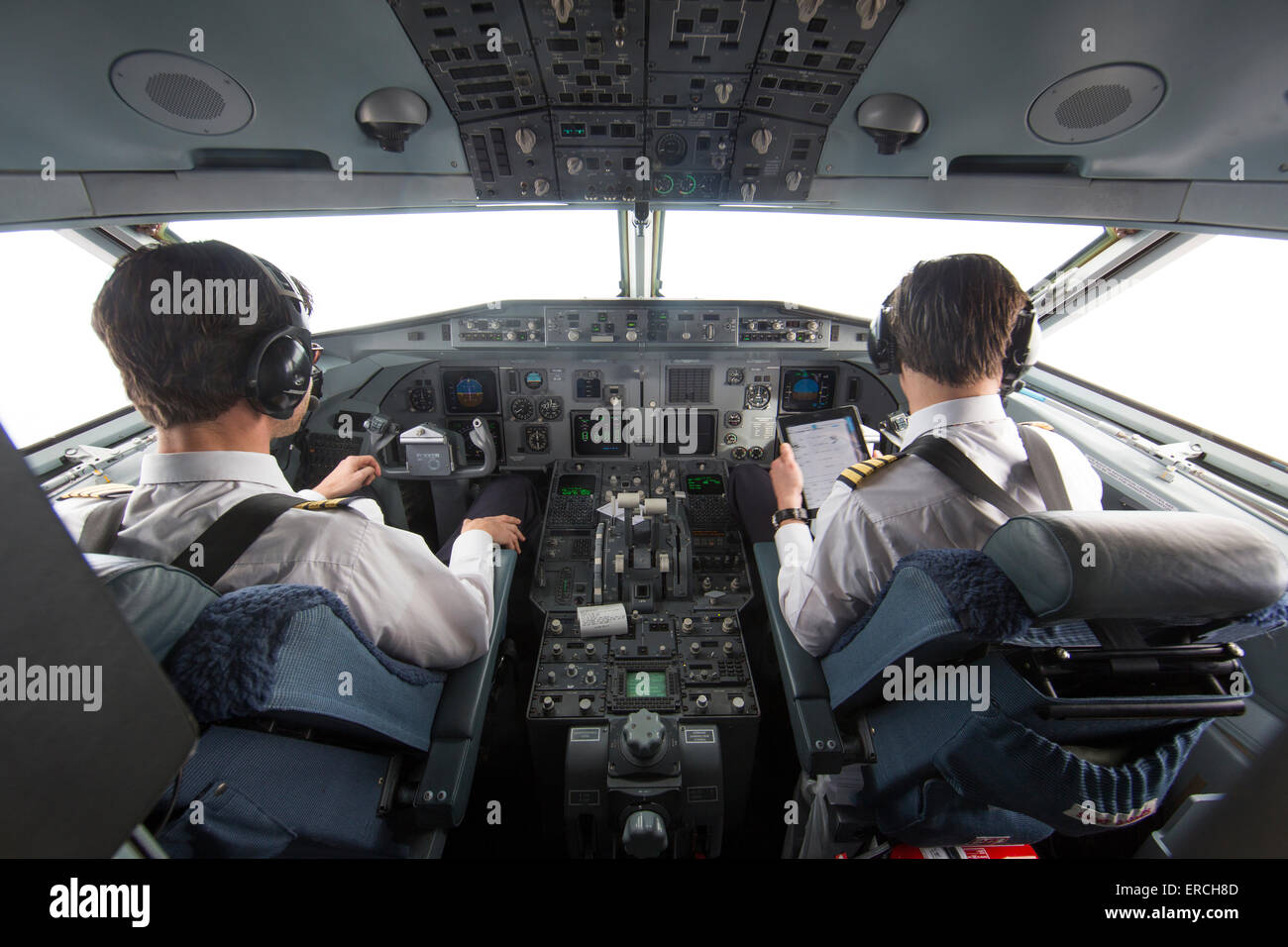 pilots in the cockpit of the KBX, Fokker 70 of the Dutch Government - Stock Image